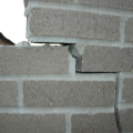 02141-burst-brick-wall